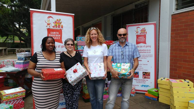 "Nick and Marina Howarth giving their ""shoe boxes"" to the Santa's Shoe Box project"